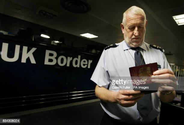 Passports are checked at passport control during the official launch of the UK Border Agency at Gatwick Airport in West Sussex