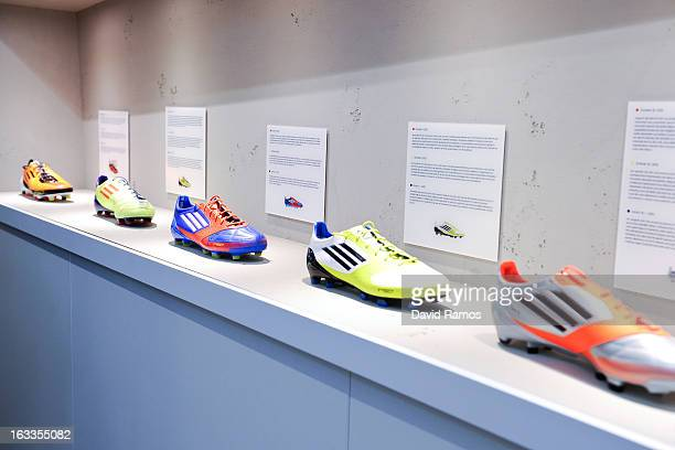 Past adizero f50 Messi boots are displayed at the new adidas Messi Gallery on March 6 2013 in Barcelona Spain