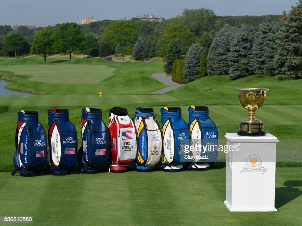 Past and present United States and International Team Captain's bags are displayed with the Presidents Cup trophy during course previews at Liberty...