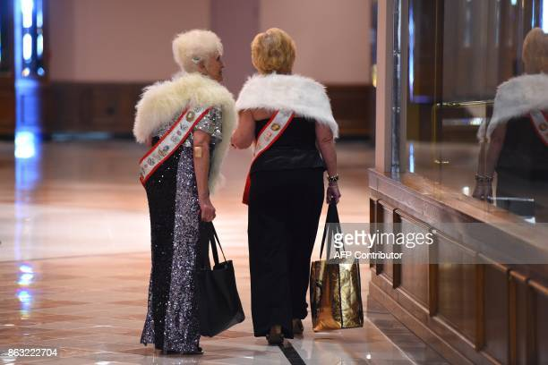 Past contestants walk down a hall before the finals of the 38th Annual National Ms Senior America 2017 Pageant held at the Resorts Casino Hotel in...