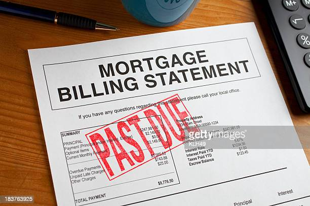Past Due Mortgage statement on a desk.