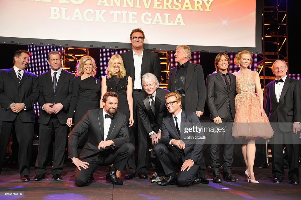 Past honorees Anthony Lapaglia, Mel Gibson, Olivia Newton-John, Hugh Jackman, Toni Collette, Luc Longley, Russell Hitchcock, Simon Baker,Graham Russell, Keith Urban, Nicole Kidman and Rod Laver onstage during the 2013 G'Day USA Los Angeles Black Tie Gala at JW Marriott Los Angeles at L.A. LIVE on January 12, 2013 in Los Angeles, California.
