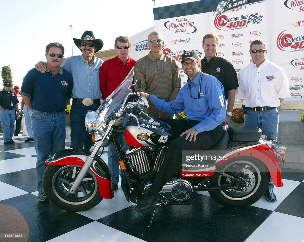 Past Winston Cup Champions, <a gi-track='captionPersonalityLinkClicked' href=/galleries/search?phrase=Terry+Labonte&family=editorial&specificpeople=241205 ng-click='$event.stopPropagation()'>Terry Labonte</a>, <a gi-track='captionPersonalityLinkClicked' href=/galleries/search?phrase=Richard+Petty&family=editorial&specificpeople=208957 ng-click='$event.stopPropagation()'>Richard Petty</a>, <a gi-track='captionPersonalityLinkClicked' href=/galleries/search?phrase=Bill+Elliott&family=editorial&specificpeople=208084 ng-click='$event.stopPropagation()'>Bill Elliott</a>, <a gi-track='captionPersonalityLinkClicked' href=/galleries/search?phrase=Dale+Jarrett&family=editorial&specificpeople=204603 ng-click='$event.stopPropagation()'>Dale Jarrett</a>, <a gi-track='captionPersonalityLinkClicked' href=/galleries/search?phrase=Rusty+Wallace&family=editorial&specificpeople=201669 ng-click='$event.stopPropagation()'>Rusty Wallace</a>, and <a gi-track='captionPersonalityLinkClicked' href=/galleries/search?phrase=Bobby+Labonte&family=editorial&specificpeople=203201 ng-click='$event.stopPropagation()'>Bobby Labonte</a> pose with Winston Cup driver <a gi-track='captionPersonalityLinkClicked' href=/galleries/search?phrase=Kyle+Petty&family=editorial&specificpeople=193827 ng-click='$event.stopPropagation()'>Kyle Petty</a> (sitting) and the autographed Victory motorcycle.
