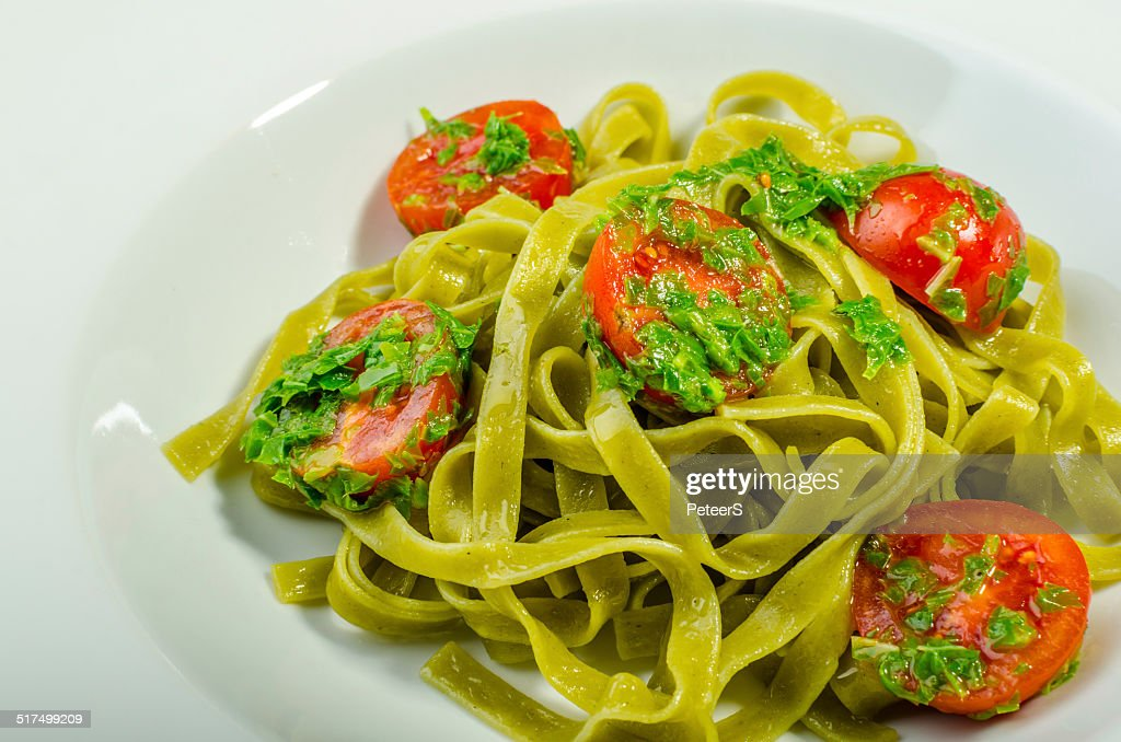 Pasta With Basil Pesto And Pine Nuts Cherry Tomatoes Stock Photo ...