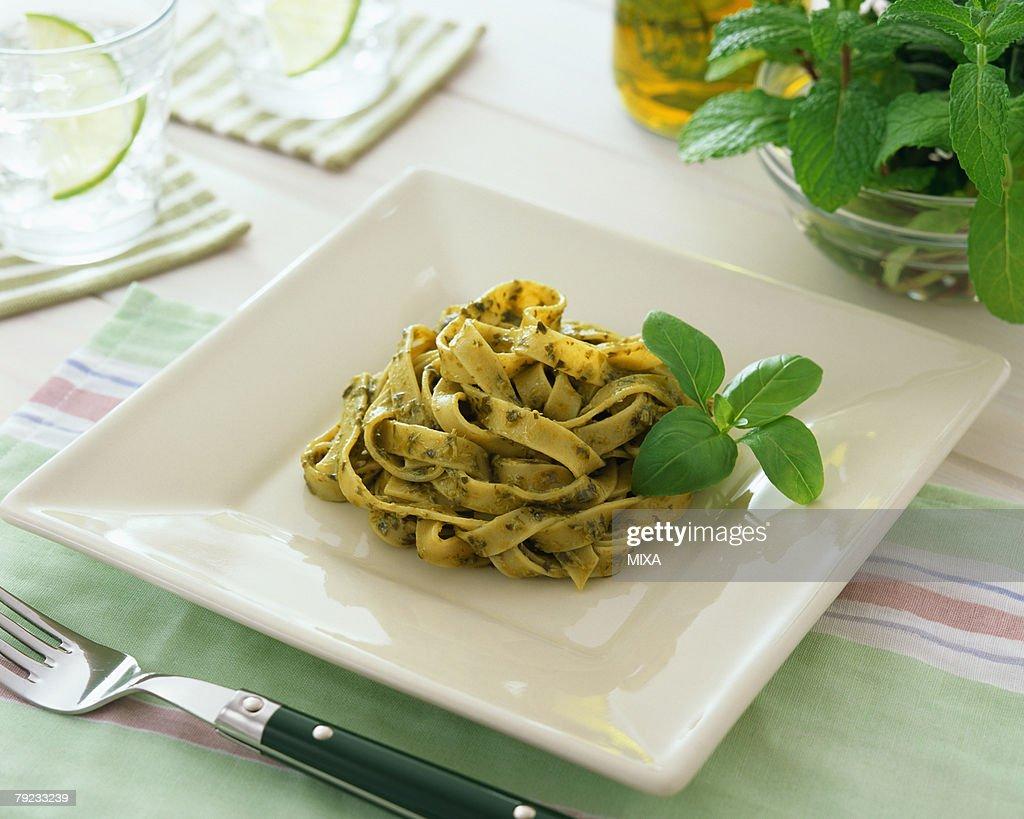 Pasta with basil sauce : Stock Photo