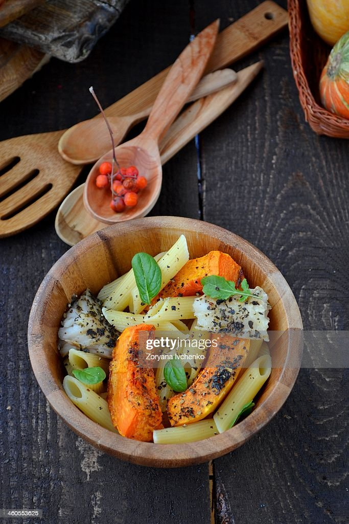Pasta with fish and pumpkin : Stock Photo