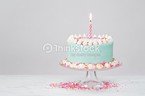 Pastel Blue Birthday Cake Over White Background Stock Foto