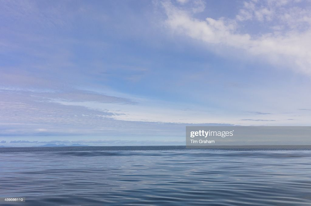 Pastel blue shades of tranquil calm waters of sea and sky scene Isle of Skye Scotland