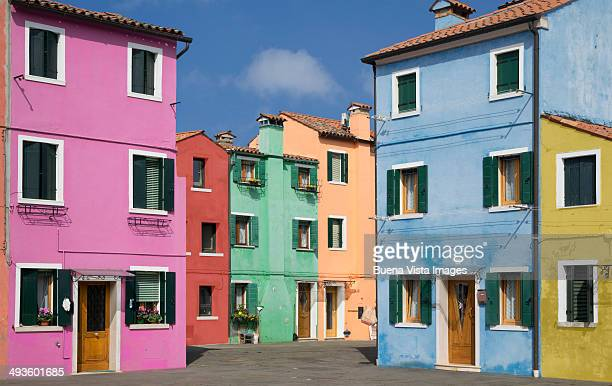 Pastel color houses over channel in Burano