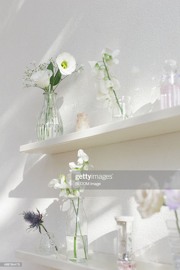 Pastel Colored Flowers In Vases On Shelves Stock Photo Getty Images