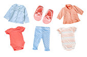 Pastel soft blue and orange colors baby clothes set.Collage child girl clothes isolated.