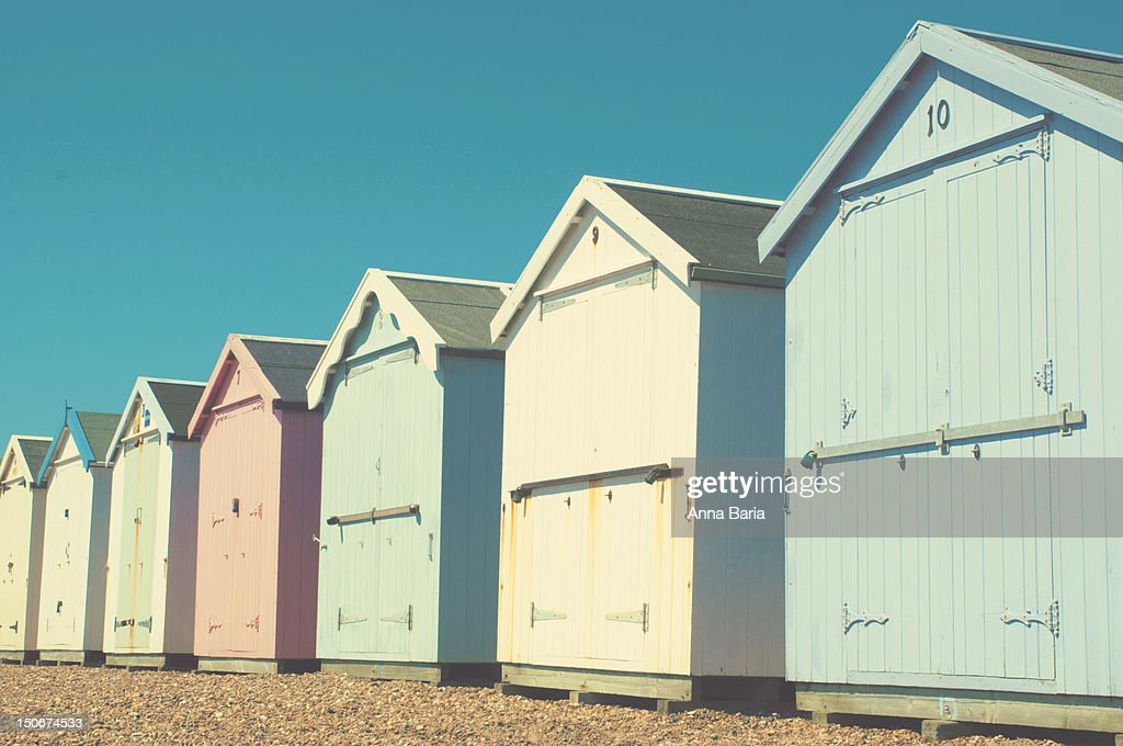 Pastel coloured beach huts : Stock Photo
