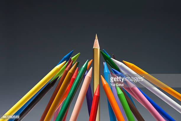 pastel crayon gather up  around the gold pencil