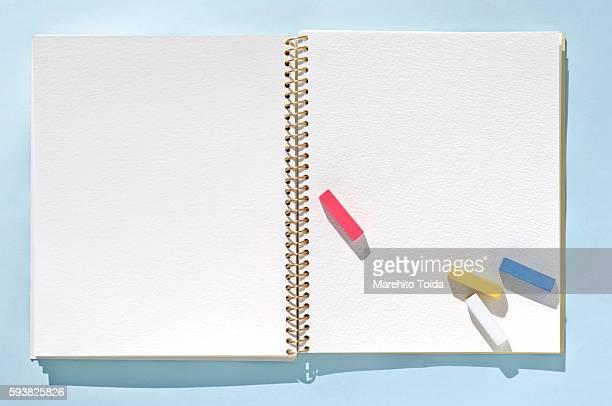 Pastel crayons and sketchbook