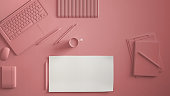 Pastel pink monochrome minimal office table desk. Workspace with laptop, notebook, pencils and coffee cup. Flat lay, top view, blank paper mockup template