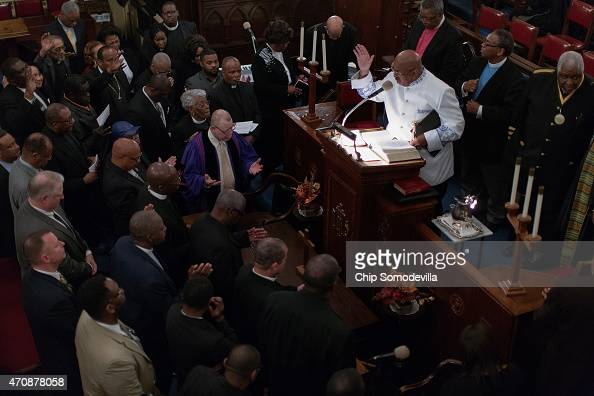 Pastor Alfred Vaughn leads fellow pastors in prayer at the end of a worship vigil for Sandtown neighborhood resident Freddie Gray at the Sharon...