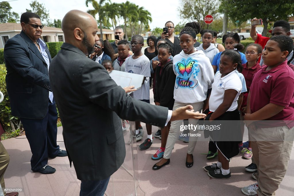 Pastor Alphonso Jackson (L) from the Second Baptist Church and Pastor Dr. Jeremy Upton, from Refuge Church, explain to children from an After School Care Program the reason why State Senator Frank Artiles resigned today from the Florida Senate on April 21, 2017 in Miami, Florida. Pastor Jackson addressed the media before speaking to the children about Mr. Artiles who resigned after he insulted two lawmakers at a Tallahassee bar with racists and sexist remarks.