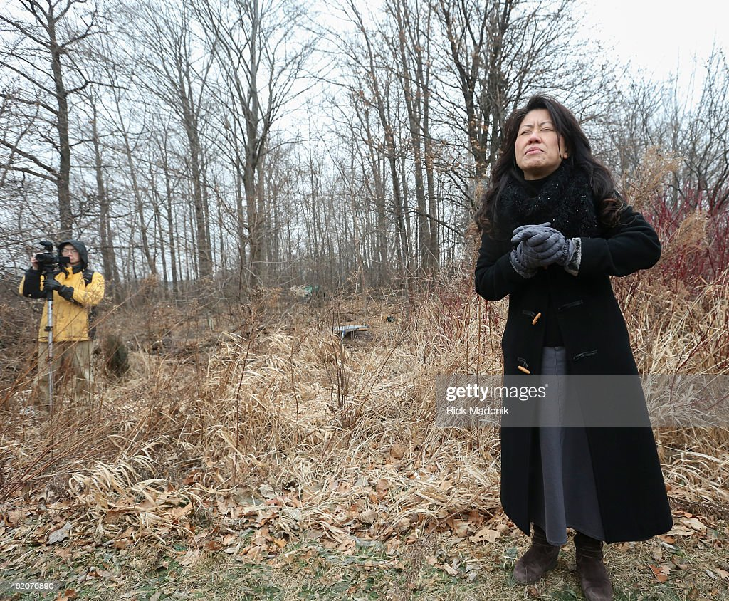 TORONTO JANUARY 24 Pastor Amy Yu from Scarborough Chinese Baptist Church offers a blessing on the trees prior to harvest The Vimy Oaks of Scarborough...