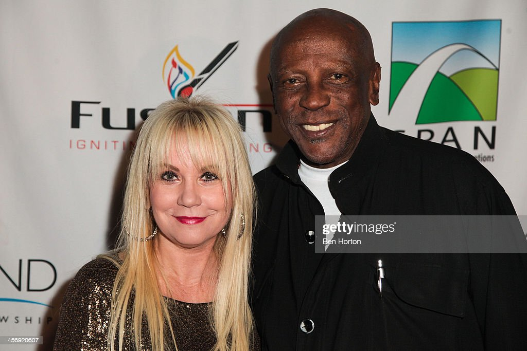 Pastor April Belt and actor Lou Gosset Jr. attend the Span Philippines Relief And Fusion Global Fundraiser at Malibu West Beach Club on December 15, 2013 in Malibu, California.