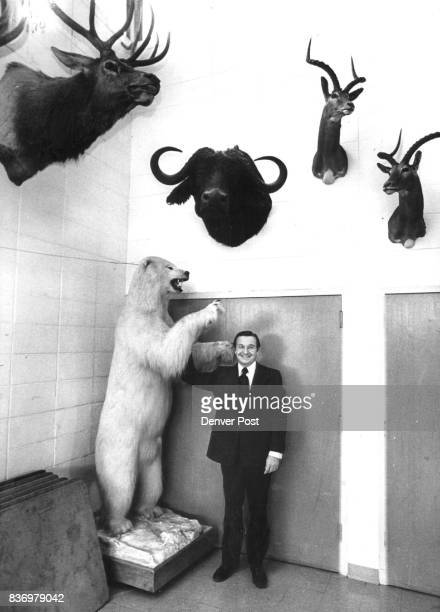 Pastor Charles E Blair shows his trophy ***** at the polar bear while on safari in the Arctic Credit Denver Post