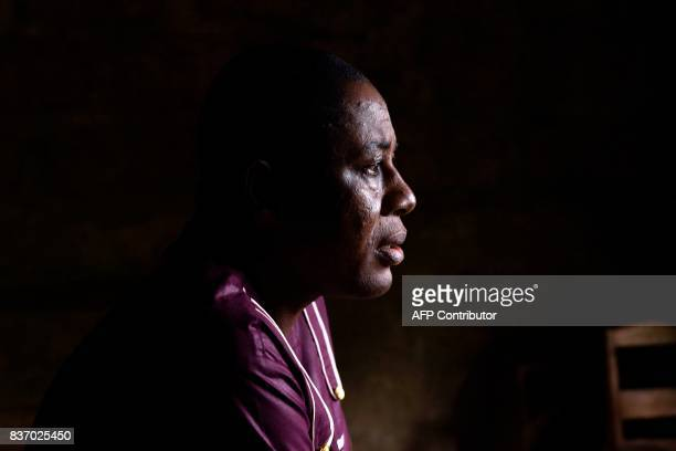 Pastor Charles O King looks on after celebrating a mass in the Royal Kings International school in Freetown on August 20 2017 A week after Sierra...