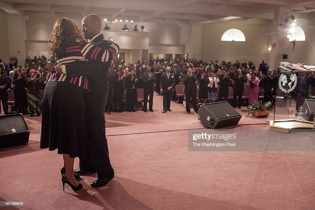Pastor Deborah Dukes and Bishop Lyle Dukes embrace during worship at Harvest Life Changers Church in Woodbridge, Virginia Sunday February 10, 2013. The Dukes have been married for 26 years and preach to a congregation of 8,000.