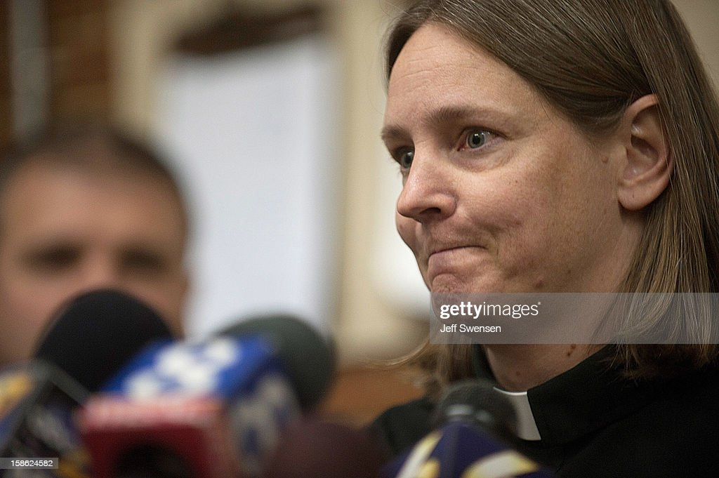 Pastor Elizabeth Hess announces a prayer vigil for the victims of a shooting in Blair County on December 21, 2012 in Geeseytown, Hollidaysburg, Pennsylvania. According to reports, a man shot and killed two men and one woman and injured three state troopers before being shot and killed by police along Juniata Valley Road in Frankstown Township.