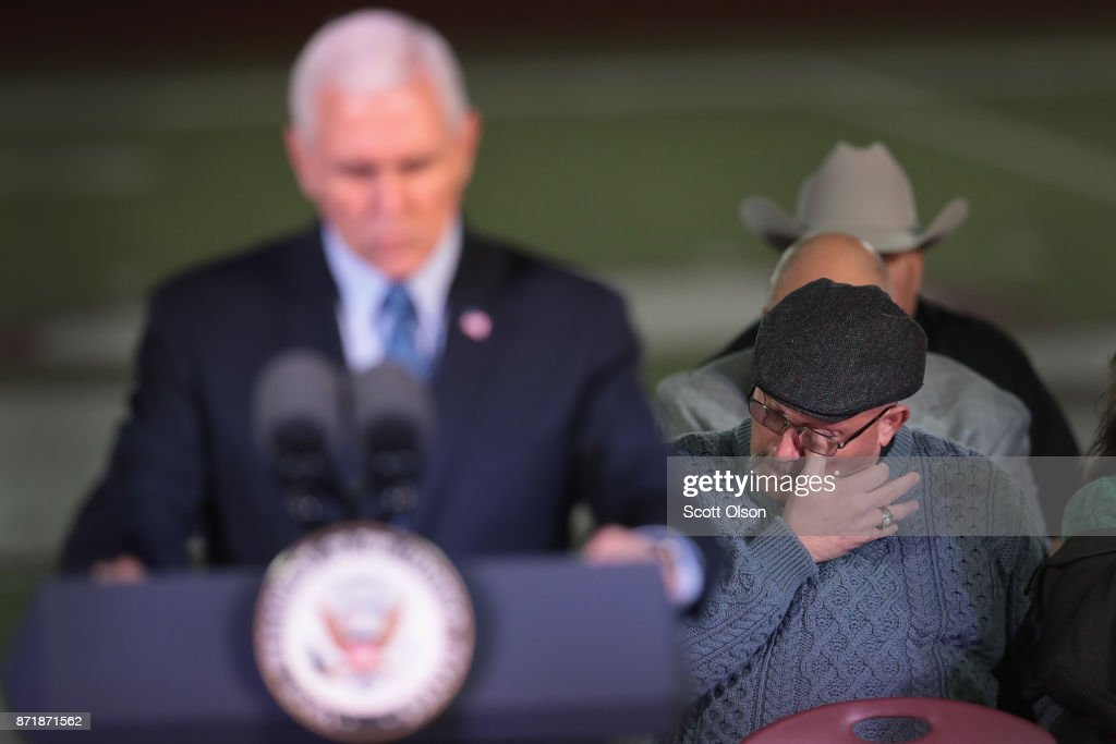 Pastor Frank Pomeroy wipes away a tear as he listens to Vice President Mike Pence speak at a memorial service for the victims of the First Baptist Church of Southerland Springs shootings at the Floresville High School on November 8, 2017 in Floresville, Texas. On November 5, a gunman, Devin Patrick Kelley, killed 26 people at the church and wounded 20 more when he opened fire during a Sunday service. Pomeroy was the pastor at the church and lost his 14-year-old daughter in the shooting.