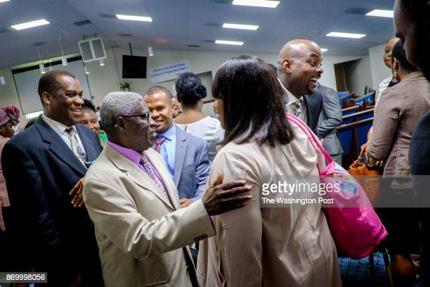 Pastor Jean St Ulme greets members of his congregation at Eglise Baptiste du Calvaire Church on Sunday August 13 2017 in Adelphi Maryland Haitian...