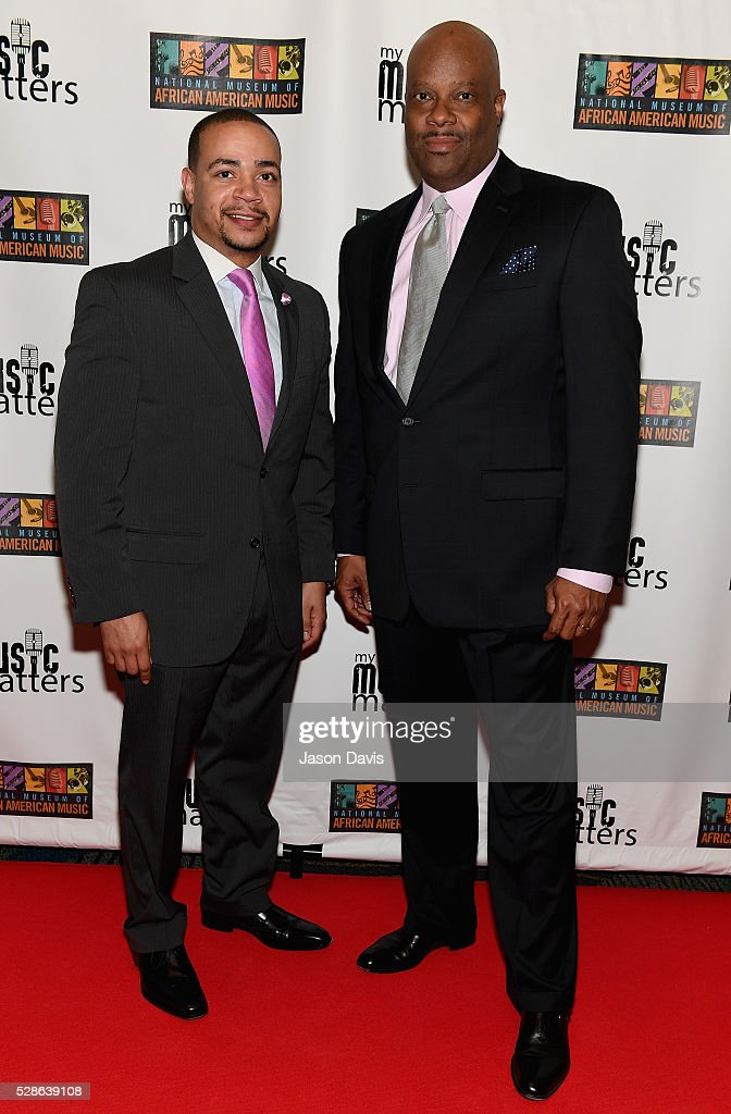 Pastor John R Faison Senior Pastor at Watson Grove Missionary Church, and H. Beecher Hicks III President & CEO at National Museum of African American Music (R) attend NMAAM's Celebration Of Legends Red Carpet And Luncheon on May 6, 2016 in Nashville, Tennessee.