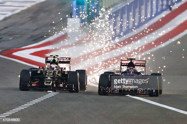Pastor Maldonado of Venezuela and Lotus and Max Verstappen of Netherlands and Scuderia Toro Rosso drive during the Bahrain Formula One Grand Prix at...