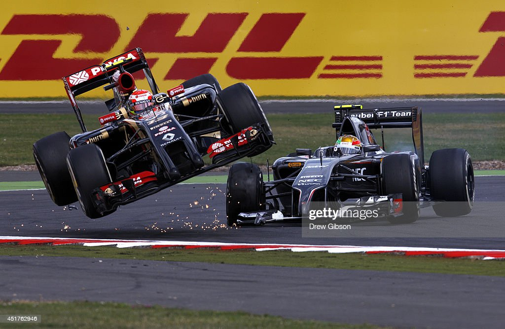 <a gi-track='captionPersonalityLinkClicked' href=/galleries/search?phrase=Pastor+Maldonado&family=editorial&specificpeople=4842574 ng-click='$event.stopPropagation()'>Pastor Maldonado</a> of Venezuela and Lotus crashes with Esteban Gutierrez of Mexico and Sauber F1 during the British Formula One Grand Prix at Silverstone Circuit on July 6, 2014 in Northampton, United Kingdom.