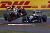 Pastor Maldonado of Venezuela and Lotus crashes with Esteban Gutierrez of Mexico and Sauber F1 during the British Formula One Grand Prix at...