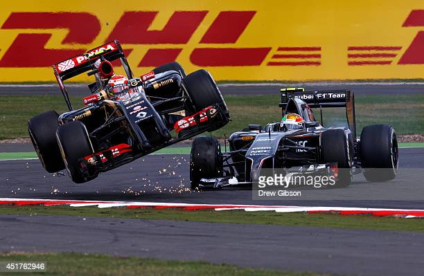 Pastor Maldonado of Venezuela and Lotus crashes with Esteban Gutierrez of Mexico and Sauber F1 during the British Formula One Grand Prix at...