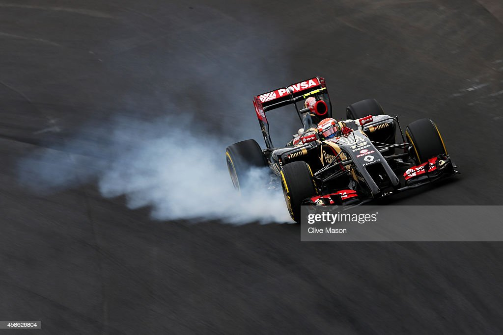 <a gi-track='captionPersonalityLinkClicked' href=/galleries/search?phrase=Pastor+Maldonado&family=editorial&specificpeople=4842574 ng-click='$event.stopPropagation()'>Pastor Maldonado</a> of Venezuela and Lotus locks up during qualifying for the Brazilian Formula One Grand Prix at Autodromo Jose Carlos Pace on November 8, 2014 in Sao Paulo, Brazil.