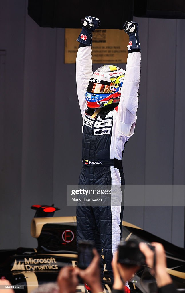 Pastor Maldonado of Venezuela and Williams celebrates in parc ferme after winning the Spanish Formula One Grand Prix at the Circuit de Catalunya on May 13, 2012 in Barcelona, Spain.