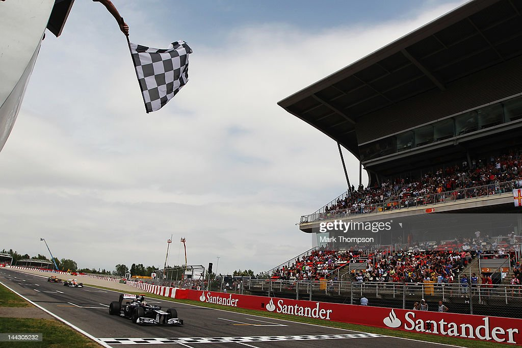 Pastor Maldonado of Venezuela and Williams crosses the finishing line to win the Spanish Formula One Grand Prix at the Circuit de Catalunya on May 13, 2012 in Barcelona, Spain.