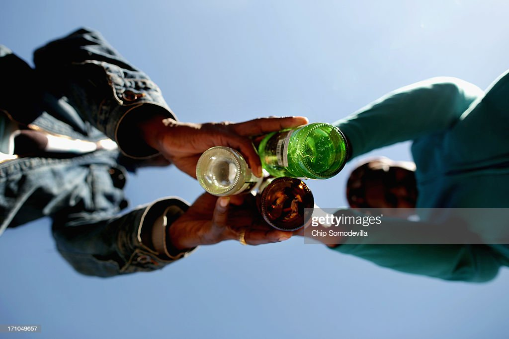 Pastor Maxwell Ncube of the Indumiso Yamakholwa In Zion church blesses bottles containing water and written prayers during a ceremony in the Yeoville neighborhood June 21, 2013 in Johannesburg, South Africa. Later in the ceremony the bottles will be smashed to release the prayers to God. The worn, arid space on top of the Yeoville hill offers worshipers of various Christian denominations from South African, Botswana, Zimbabwe, the Democratic Republic of Congo and other African nations an open-air space where they can publicly practice their faith with a scenic view of downtown Johannesburg.