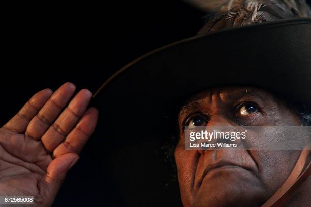 Pastor Ray Minniecon salutes during a service at Redfern Park while wearing his Grandfather's Lighthorseman uniform in Redfern on April 25 2017 in...