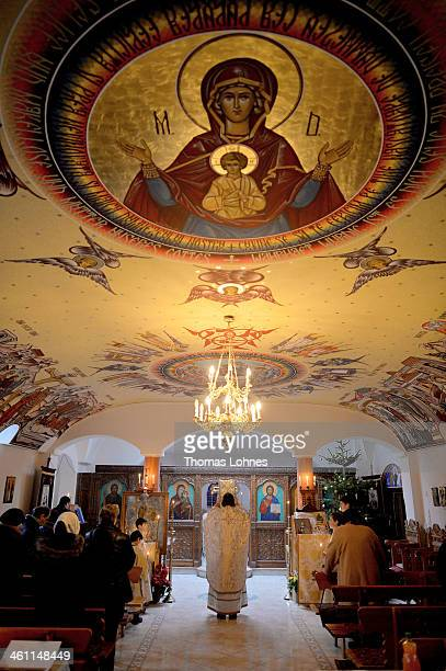Pastor Stefan Anghel celebrates with Romanian Orthodox believers the birth of John the Baptist on January 7 2014 in Offenbach/Main Germany The...