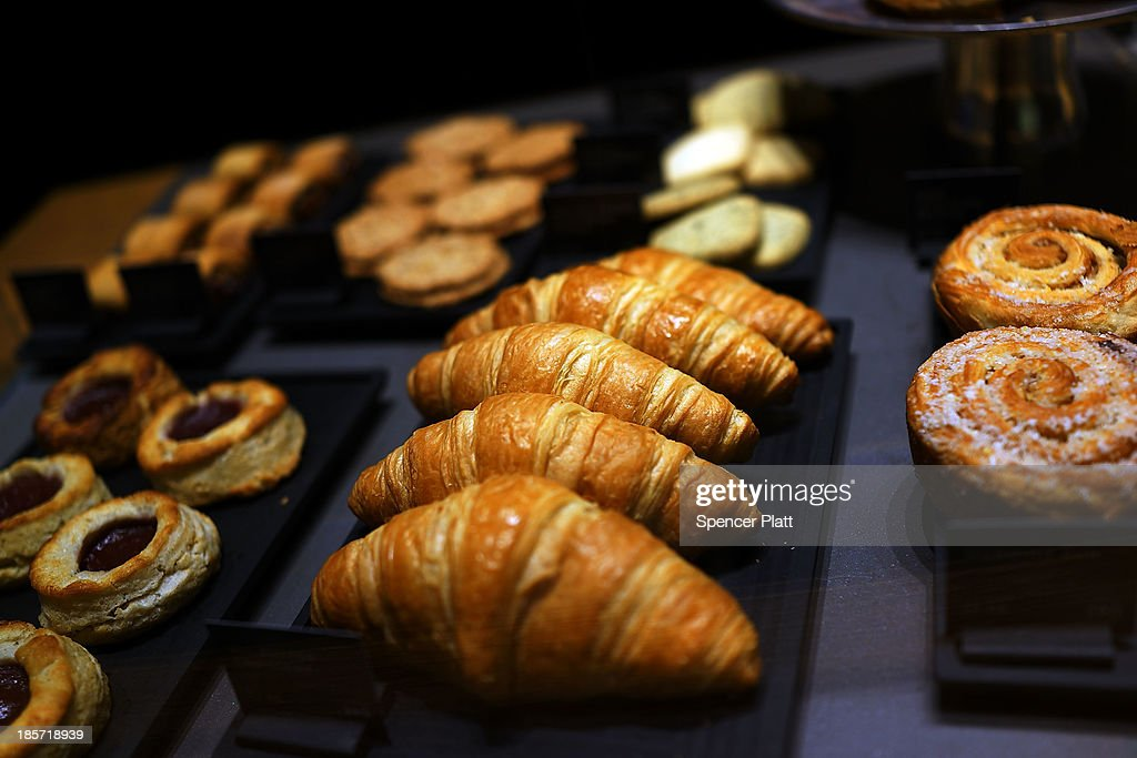 Pastries are are on display at the newly opened Teavana 'tea bar' on October 24 2013 in New York City Teavana which Starbucks bought last year was...