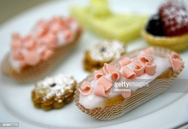 Pastries are arranged for a photograph in the Palm Court at the Plaza Hotel in New York US on Monday March 17 2008 Recession What recession The Plaza...