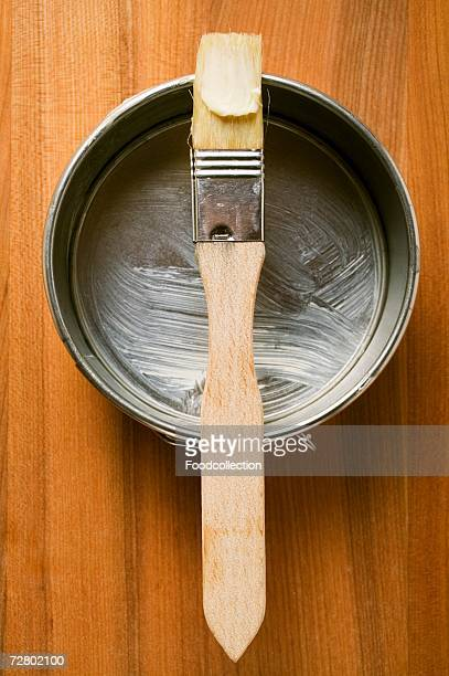 Pastry brush with butter on baking tin