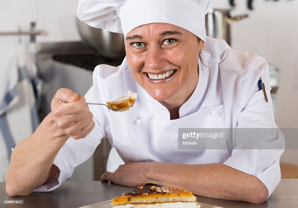 Pastry chef decorating : Stock Photo