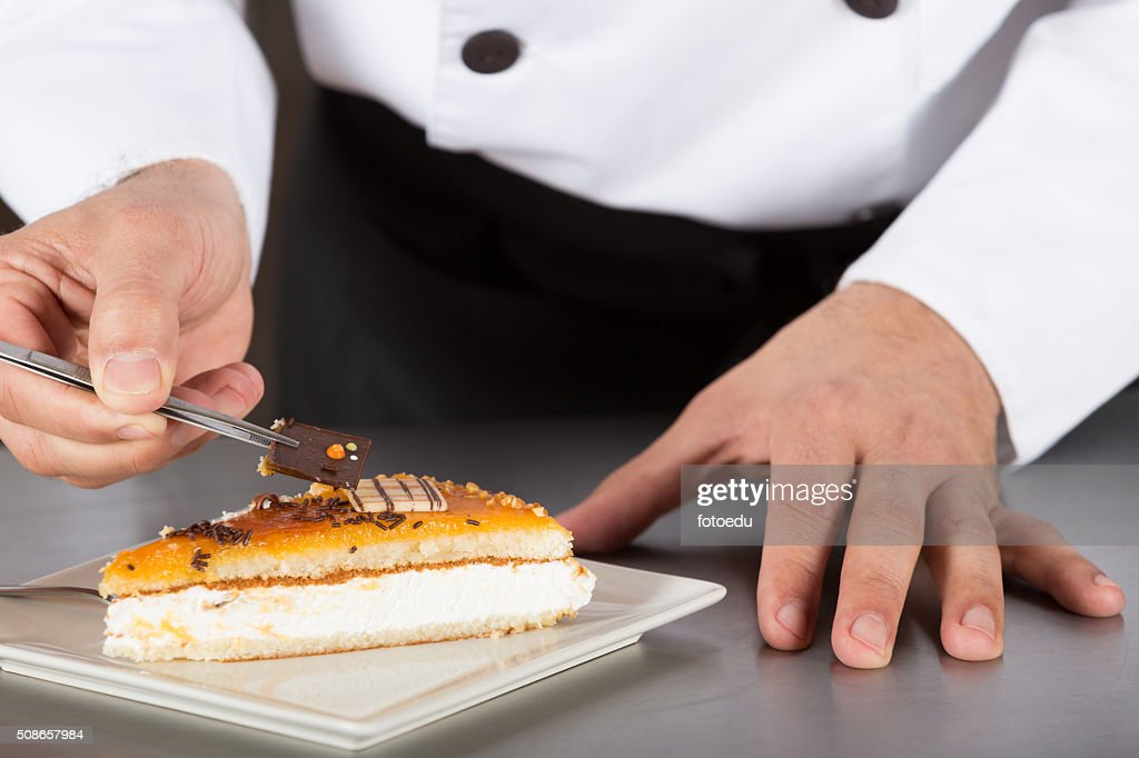 Pastry chef decorating : Stock Photo