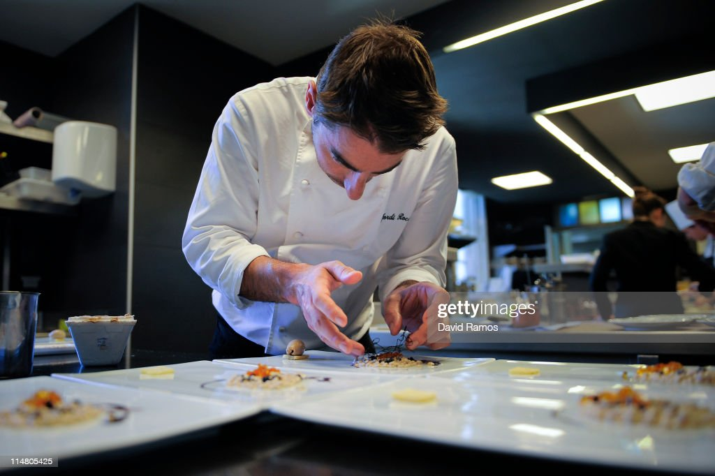 pastry chef jordi roca brother of chef joan roca prepares a dish at the