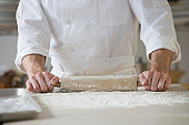 Pastry chef rolling out dough