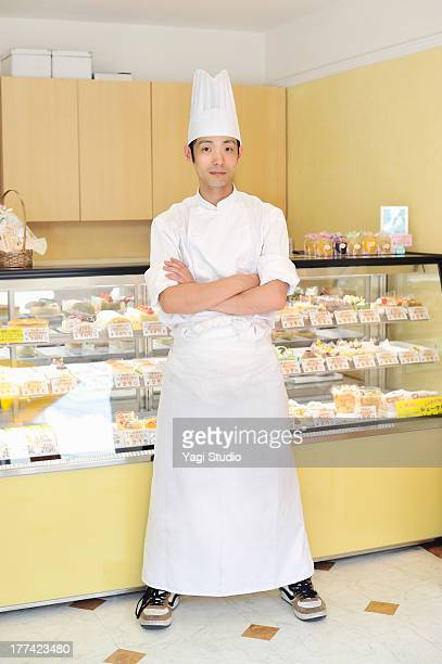 Pastry Chef standing in cake shop