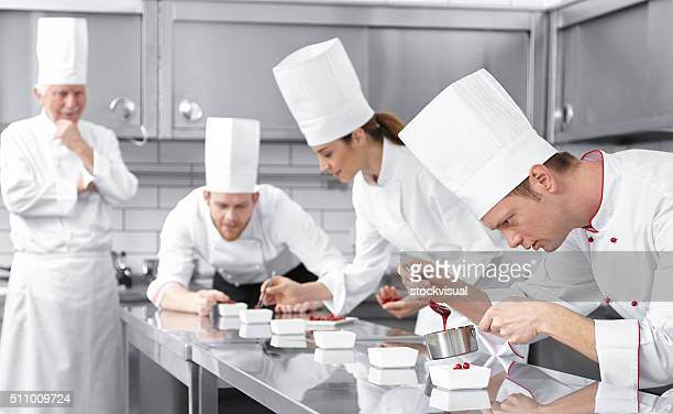 Pastry chefs decorating desserts