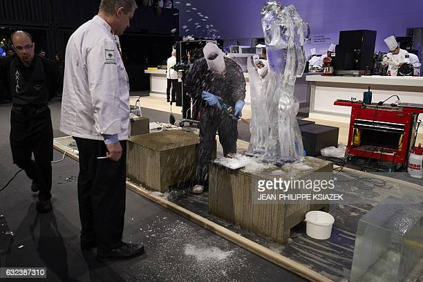 A pastry's chef sculpts ice during the Pastries World Cup final on January 22 2017 in Chassieu outside Lyon as part of the Catering and Food...